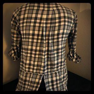 Tops - Women's plaid flannel top.